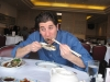 Lee eats LARGE oysters in black bean sauce.
