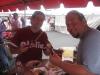 Bert & Lee begin eating ribs ...