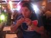 Lee eats flatbread pizza.