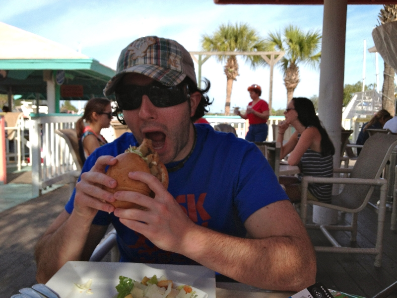 Lee eats a soft shell crab sandwich (Jacksonville Beach)