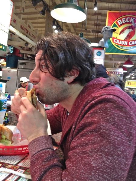 Lee eats a fried oyster po-boy @ Beck\'s Cajun Cafe (Philly)