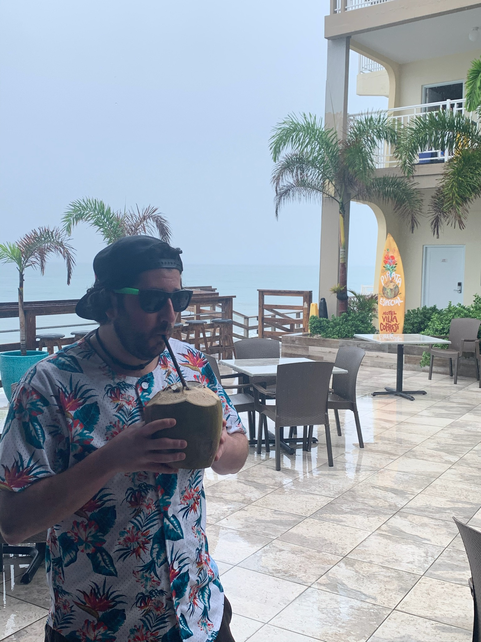 Lee eats (drinks) a Pirata in Rincon, Puerto Rico (Pre-Covid)..