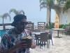 Lee eats (drinks) a Pirata in Rincon, Puerto Rico (Pre-Covid)..