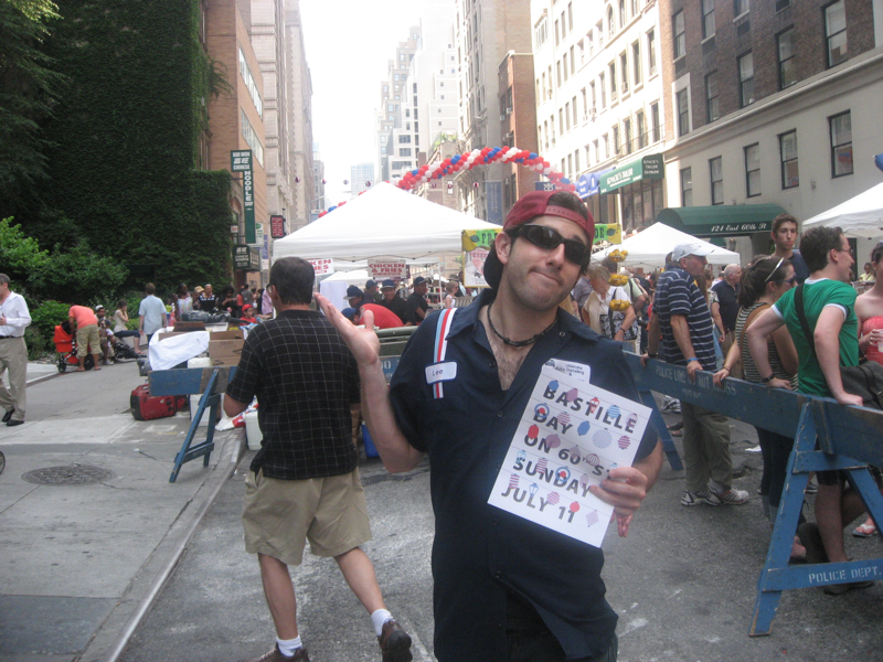 Lee shrugs at Bastille Day (NYC)
