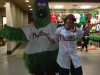 Lee shrugs at/with the (cut out) Phanatic