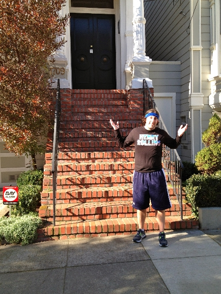 Lee shrugs in front of the Full House house (San Francisco)