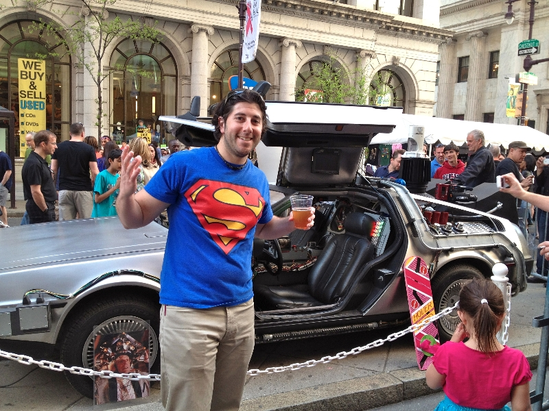 Lee shrugs at the DeLorean (PIFA Street Fair, Philly)