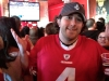 Lee (wearing an Andy LEE jersey) shrugs at the NFC Championship (San Francisco)