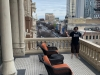 Lee shrugs from hotel room deck in Austin, TX (Pre-Covid).