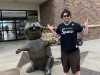 Lee shrugs at/with Buc-ee's in Texas (Pre-Covid).