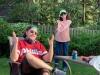 Lee shrugs w Bobbie P. in folks' backyard.