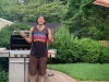 Lee shrugs grilling.